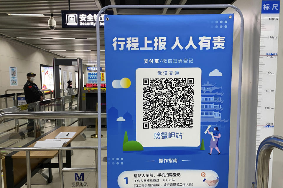 """In this April 1, 2020, photo, a QR code is set up for passengers to check their green pass status at a subway station in Wuhan in central China's Hubei province. Life in China post-coronavirus outbreak is ruled by a green symbol on a smartphone screen. Green signifies the """"health code"""" that says the user is symptom-free. It is required to board a subway, check into a hotel or enter Wuhan, the city where the global pandemic began. (AP Photo/Ng Han Guan)"""