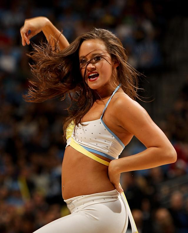 DENVER, CO - APRIL 25: A Denver Nuggets dancer performs during a break in the action against the Oklahoma City Thunder in Game Four of the Western Conference Quarterfinals in the 2011 NBA Playoffs at Pepsi Center on April 25, 2011 in Denver, Colorado. NOTE TO USER: User expressly acknowledges and agrees that, by downloading and or using this photograph, User is consenting to the terms and conditions of the Getty Images License Agreement. (Photo by Justin Edmonds/Getty Images)