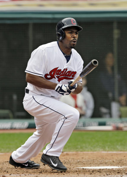 Cleveland Indians' Michael Bourn triples off Houston Astros pitcher Philip Humber to drive in two runs in the sixth inning of a baseball game on Sunday, Sept. 22, 2013, in Cleveland. (AP Photo/Mark Duncan)