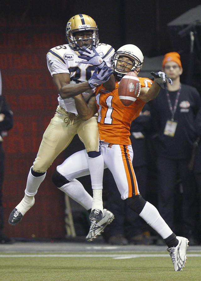 VANCOUVER, CANADA - NOVEMBER 27: Tad Kornegay #11 of the BC Lions knocks the ball away from Clarence Denmark #89 of the Winnipeg Blue Bombers in the end zone during the CFL 99th Grey Cup November 27, 2011 at BC Place in Vancouver, British Columbia, Canada. (Photo by Jeff Vinnick/Getty Images)