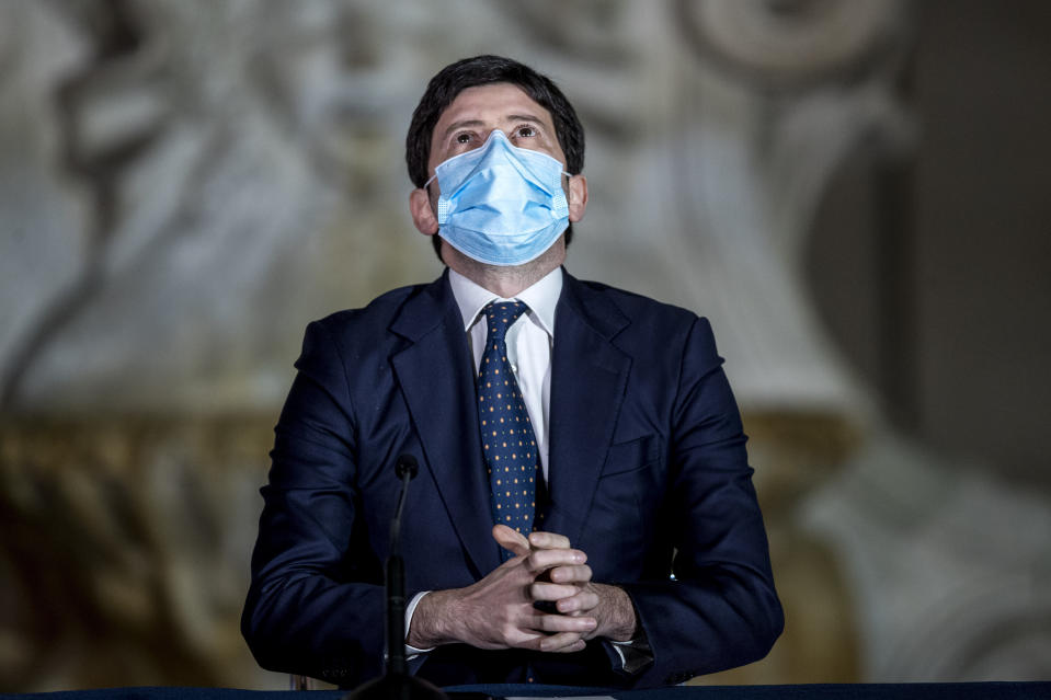 Italian Health Minister Roberto Speranza meets the media to illustrate the government's new measures to curb the spread of COVID-19 in Rome, Tuesday, March 2, 2021. The first anti-pandemic decree from Italy's new premier, Mario Draghi, tightens measures governing school attendance while easing restrictions on museums, theaters and cinemas. (Roberto Monaldo/LaPresse via AP)