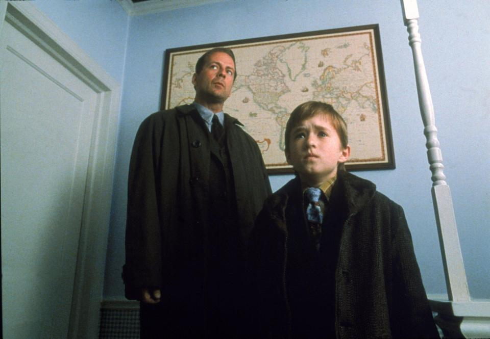 """Bruce Willis is a child psychologist and Haley Joel Osment is a kid who sees ghosts in """"The Sixth Sense."""""""