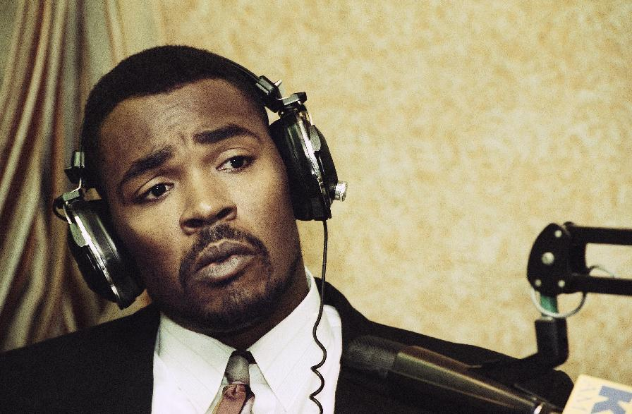 "FILE - This July 20, 1993 file photo shows Rodney King speaking during an appearance on KFI-AM radio's ""Bill Handel and Mark Whitlock"" show in Los Angeles. King, the black motorist whose 1991 videotaped beating by Los Angeles police officers was the touchstone for one of the most destructive race riots in the nation's history, has died, his publicist said Sunday, June 17, 2012. He was 47. (AP Photo/Nick Ut, file)"