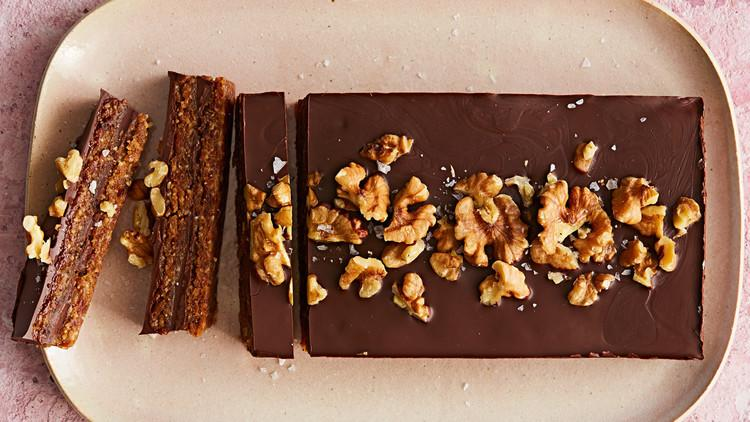 """<p>Here's a <a href=""""https://www.marthastewart.com/1512904/healthy-baked-treats-taste-really-good"""">healthy way to satisfy your sweet tooth</a>. These no-bake, flourless bars get their body from walnut pieces, chopped dates, peanut butter, and semisweet chocolate chunks.</p>"""