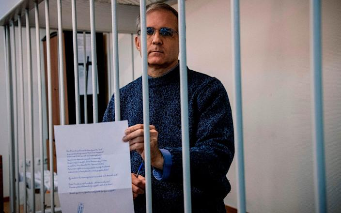 Paul Whelan, a former US Marine accused of espionage and arrested in Russia in December 2018, standing inside a defendants' cage during a hearing in 2019 - DIMITAR DILKOFF/AFP