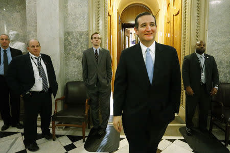 U.S. Senator Ted Cruz smiles as he departs the Senate floor after it passed at $1.1 trillion spending bill at the U.S. Capitol in Washington