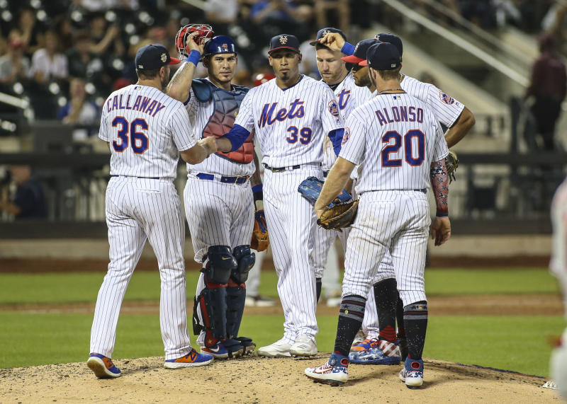 Jul 5, 2019; New York City, NY, USA; New York Mets manager Mickey Callaway (36) removes pitcher Edwin Diaz (39) from the game in the ninth inning against the Philadelphia Phillies at Citi Field. Mandatory Credit: Wendell Cruz-USA TODAY Sports