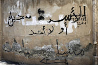 "In this Saturday, July 27, 2019 photo, Arabic graffiti reads, ""Assad, we love you or no one else,"" in Aleppo, Syria. Rebels still frequently strike with shelling and mortars into Aleppo, killing civilians nearly three years after the government recaptured the city. Aleppo is a symbol of how President Bashar Assad succeeded in turning the tide in Syria's long civil war with a series of wins, but it's equally a symbol of how he's been unable to secure a final victory. Half of Aleppo remains in ruins, and rebels remain on the doorstep. (AP Photo/Hassan Ammar)"