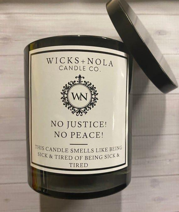 """<p><strong>WicksNOLA</strong></p><p>etsy.com</p><p><strong>$25.00</strong></p><p><a href=""""https://go.redirectingat.com?id=74968X1596630&url=https%3A%2F%2Fwww.etsy.com%2Flisting%2F806982570%2Fno-justice-no-peace-11oz-scented-coconut&sref=https%3A%2F%2Fwww.cosmopolitan.com%2Fstyle-beauty%2Fg33514157%2Fblack-owned-etsy-shops%2F"""" rel=""""nofollow noopener"""" target=""""_blank"""" data-ylk=""""slk:Shop Now"""" class=""""link rapid-noclick-resp"""">Shop Now</a></p><p>The message on these candles is enough to want to stock up on 'em, but the yummy scents will make you want to burn them 24/7.</p>"""