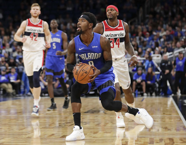 Orlando Magic's Terrence Ross center, lines up a shot as he gets in front of Washington Wizards' C.J. Miles (34) during the second half of an NBA basketball game, Sunday, Nov. 17, 2019, in Orlando, Fla. (AP Photo/John Raoux)