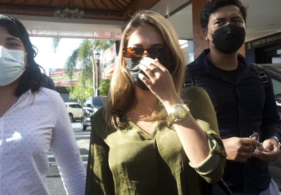 Russian influencer Leia Se, centre, walks from the immigration office at Jimbaran, Bali, Indonesia on Friday, April 30, 2021