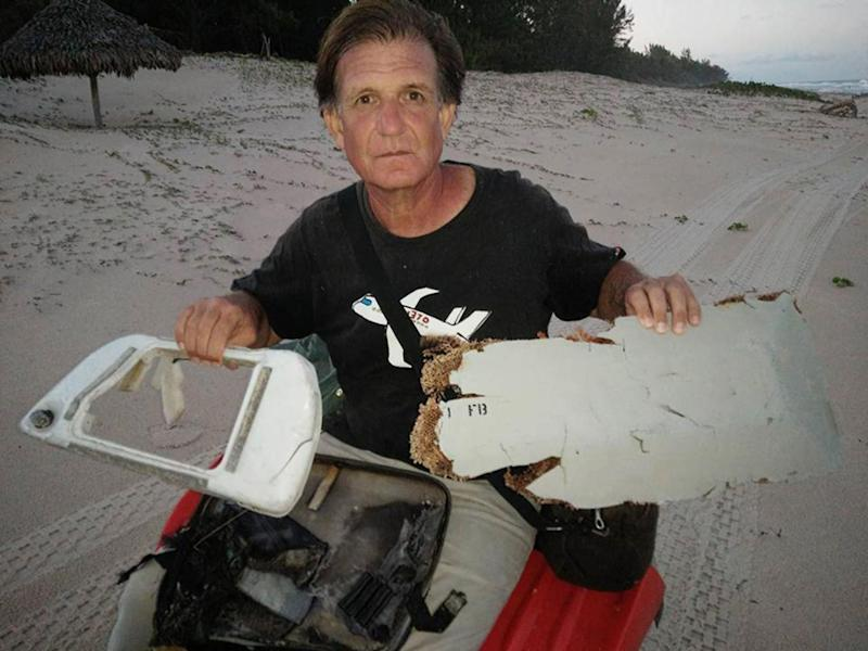 Blaine Gibson with suspected MH370 debris that he found on a beach in Madagascar (Blaine Alan Gibson)