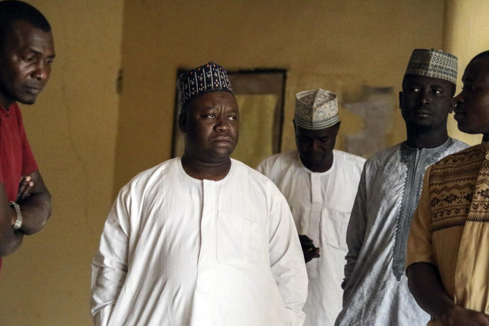 Parents of missing schoolgirls wait for news of the more than 300 girls who were abducted by gunmen on Friday from the Government Girls Junior Secondary School, in Jangebe town, Zamfara state, northern Nigeria Sunday, Feb. 28, 2021. Families in Nigeria waited anxiously on Sunday for news of their abducted daughters, the latest in a series of mass kidnappings of school students in the West African nation. (AP Photo/Ibrahim Mansur)