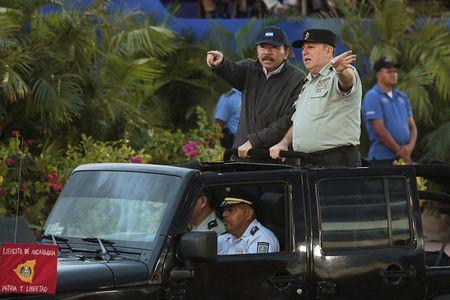Nicaragua's President Daniel Ortega (L) speaks with Commander in Chief of the Army of Nicaragua, General Julio Cesar Aviles, during a military parade commemorating the 36th anniversary of the founding of the Nicaraguan army at the Juan Pablo II square in Managua, Nicaragua, September 3, 2015. REUTERS/Oswaldo Rivas