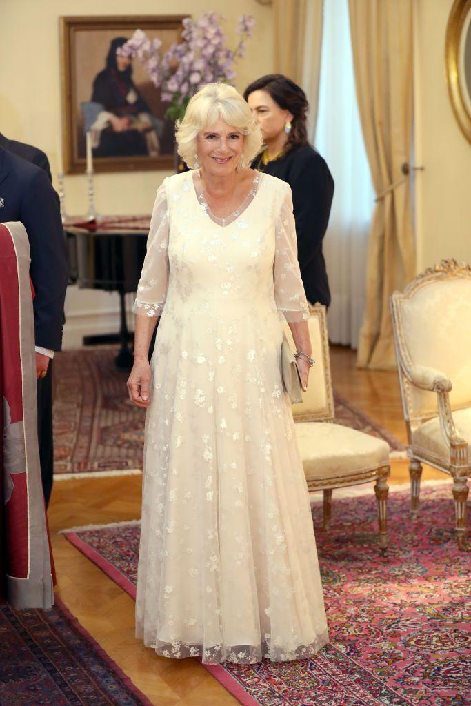 <p>At a dinner with the President of Greece in Athens, Camilla donned this butter yellow dress with a floral overlay and sheer sleeves. </p>