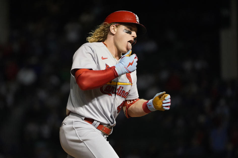 St. Louis Cardinals' Harrison Bader celebrates his home run off Chicago Cubs relief pitcher Adam Morgan in front of the Chicago Cubs bench during the seventh inning of a baseball game Friday, Sept. 24, 2021, in Chicago. (AP Photo/Charles Rex Arbogast)