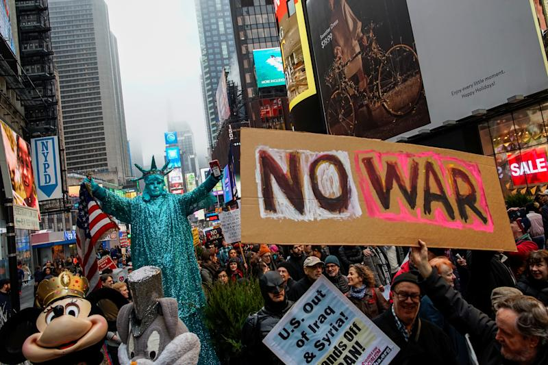 People march as they take part in an anti-war protest amid increased tensions between the United States and Iran at Times Square in New York, U.S., January 4, 2020. REUTERS/Eduardo Munoz