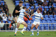 New Zealand's Jordie Barrett, left, competes for the ball against Argentina's Juan Cruz Mallia during their Rugby Championship match on Sunday, Sept. 12, 2021, on the Gold Coast, Australia. (AP Photo/Tertius Pickard)