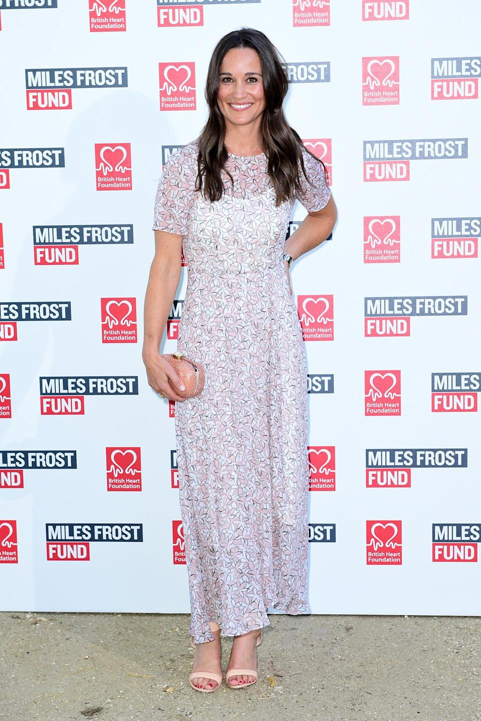 <p>Pippa turned to the high street for her Frost Summer Party dress last year. Donning a £365 floaty and floral L.K. Bennett dress, the brunette looked wonderfully summery. <i>[Photo: PA Images]</i> </p>