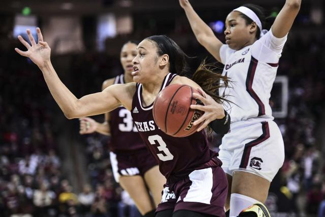 FILE - In this Sunday, March 1, 2020, file photo, Texas A&M guard Chennedy Carter (3) drives against South Carolina guard Zia Cooke (1) during the second half of an NCAA college basketball game in Columbia, S.C. Carter has submitted paperwork to enter the WNBA draft, which is scheduled to be held April 17, 2020. (AP Photo/Sean Rayford, File)