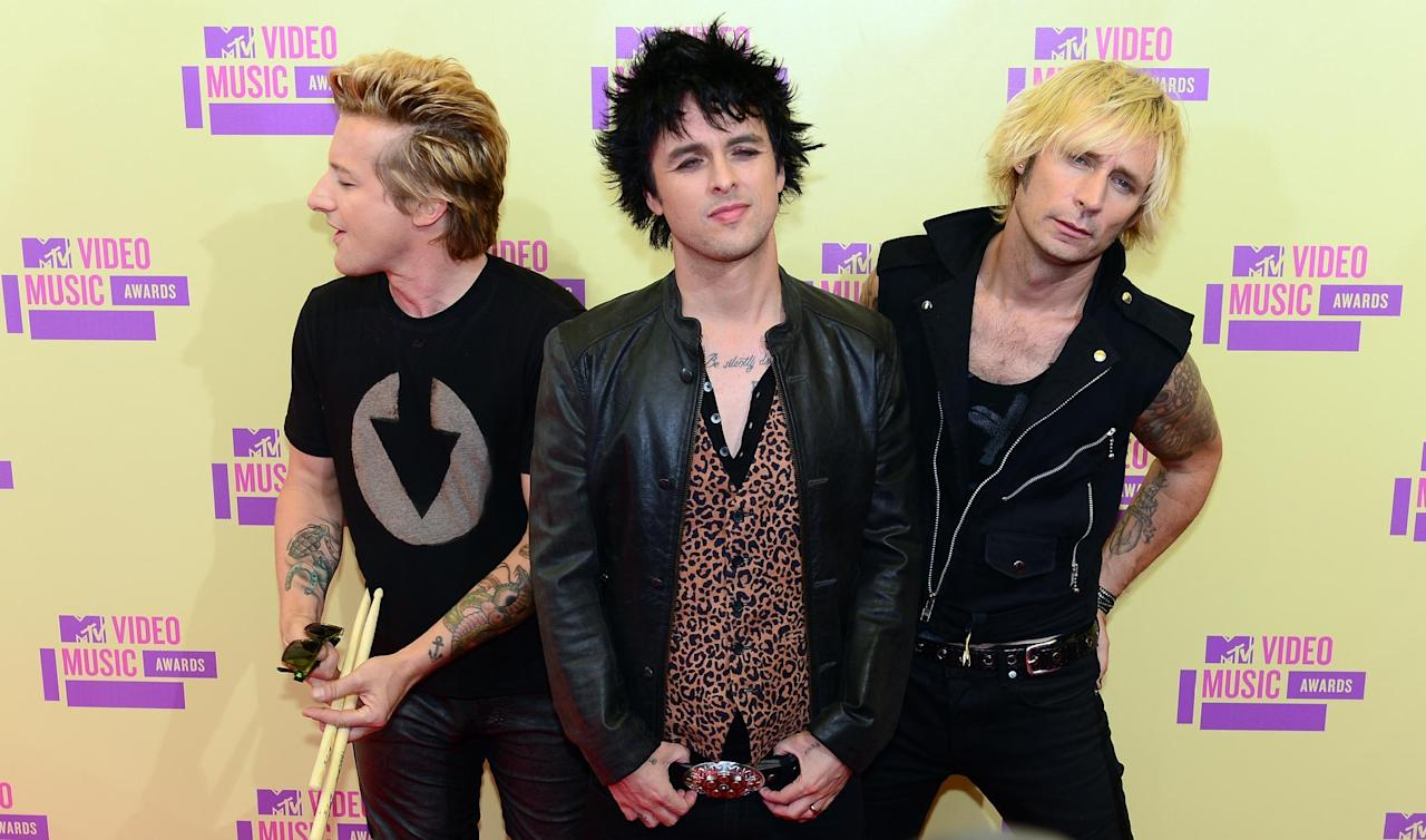 Green Day pose on arrival on the red carpet for the MTV Video Music Awards in Los Angeles on September 6, 2012 in California.