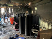 Burned oxygen cylinders are seen in the intensive care unit of the Ibn al-Khatib hospital following a fire that broke out of last Saturday evening killing over 80 people and injuring over 100, in Baghdad, Iraq, Tuesday, April 27, 2021. Medical staff who witnessed the first moments of the fire described horrific scenes: deafening screams, a patient who jumped to his death to escape the inferno and relatives who died because they refused to abandon coronavirus patients tethered to ventilators. (AP Photo/Khalid Mohammed)