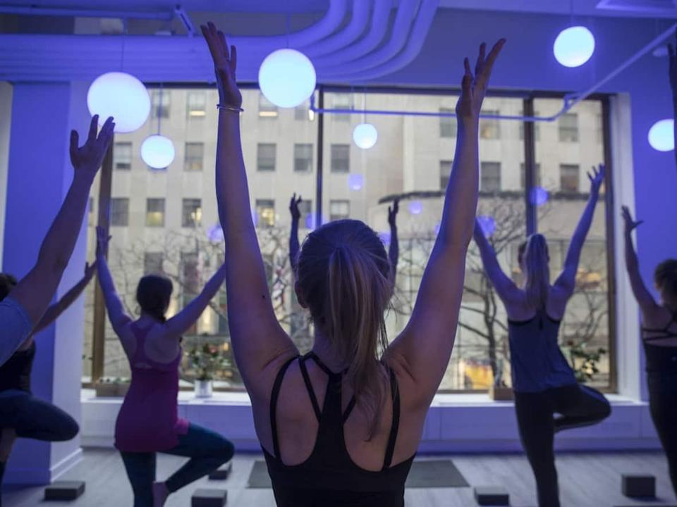 So-called athleisure clothing, such as yoga gear, is hugely popular, as consumers are increasingly blurring the lines between office attire and what they would wear around the house. (Victor J. Blue/Bloomberg - image credit)