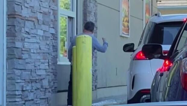 Video posted online captured a man accusing of yelling racist slurs at people at a drive-thru in Richmond, B.C., on May 1. RCMP found the man and later confirmed he will not face criminal charges in connection with the incident. (YouTube/Ben W - image credit)