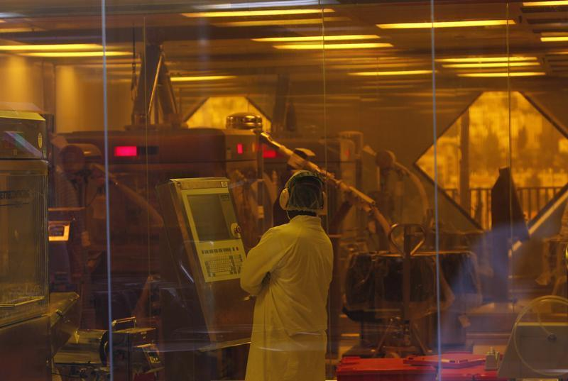An employee of Teva stands in Jerusalem oral solid dosage plant