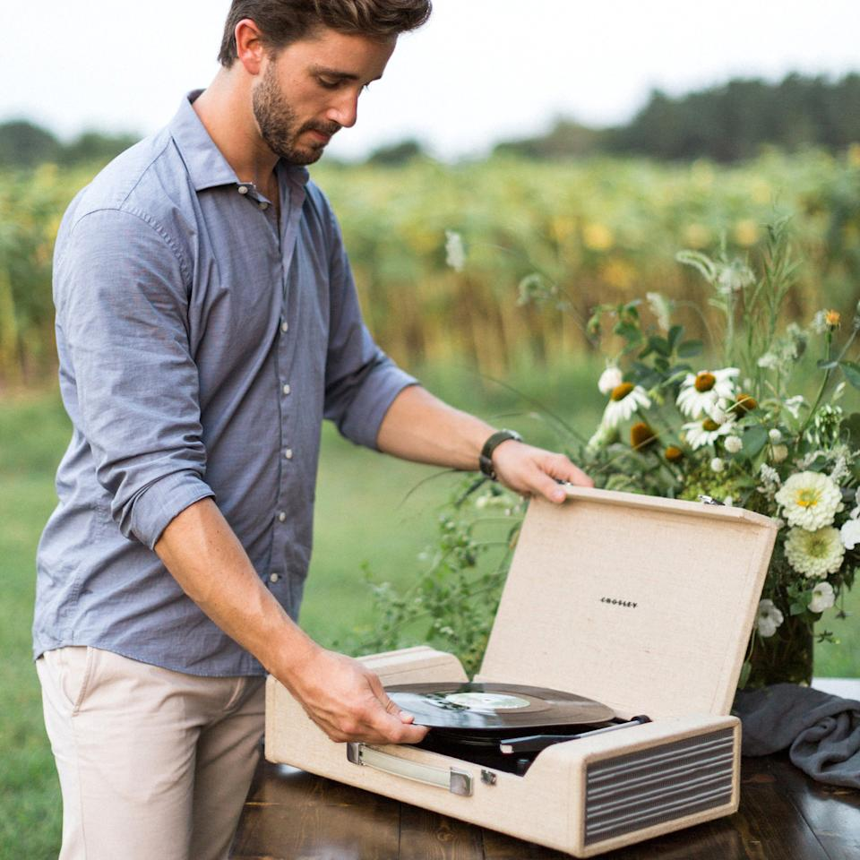 """<p>Play your favorite tunes or a romantic playlist with this portable turntable by Crosley that can also turn your favorite vinyls into digital files. Even better-make it a party night and invite all your friends to sing karaoke at your house with <a rel=""""nofollow"""" href=""""https://www.zola.com/shop/product/singtrix_party_bundle?utm_source=InStyle&utm_campaign=Relive_Creative_Engagement&utm_medium=Referral"""">this system by Singtrix</a>.</p><p>$180 