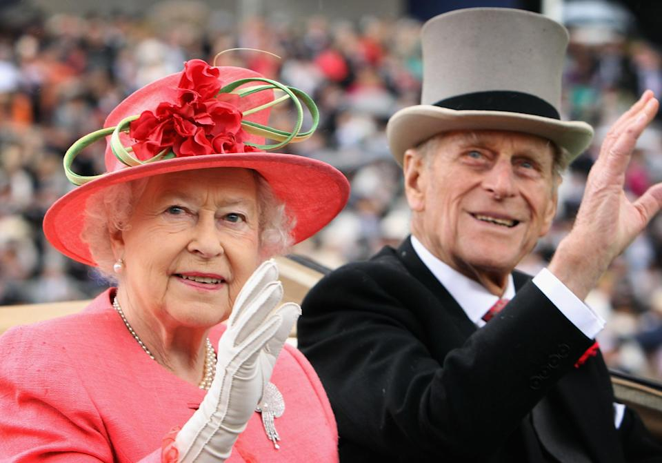 Queen Elizabeth ll and Prince Philip arrive in an open carriage on Ladies Day at Royal Ascot on June 16, 2011Getty Images