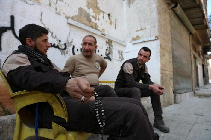 Syrian emergency personnel sit outside their centre on February 29, 2016 in the Bab al-Nairab neighborhood of Aleppo (AFP Photo/Karam al-Masri)