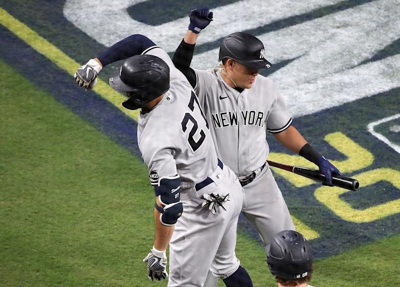 Giancarlo Stanton makes postseason home run history after hitting his fourth an fifth homers in four games. (Photo by Sean M. Haffey/Getty Images)