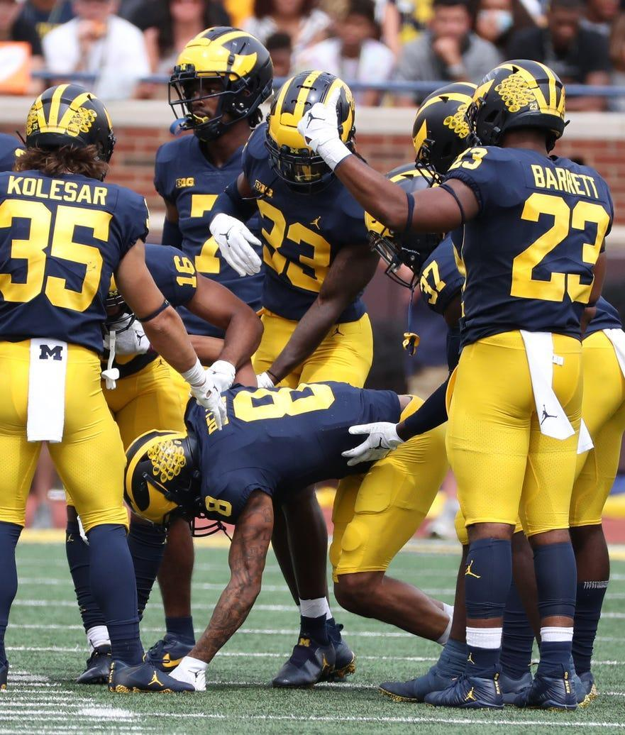 Michigan Wolverines wide receiver Ronnie Bell (8) goes down due to injury during first half action against the Western Michigan Broncos on Saturday, Sept. 4, 2021.