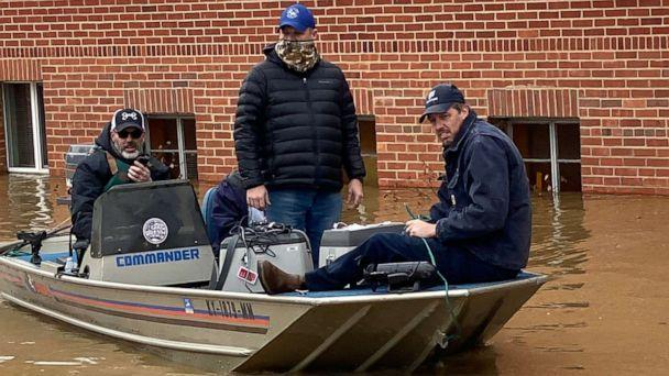 PHOTO: An emergency crew helps transport 150 doses of COVID-19 vaccine through floodwaters in Beattyville, Ky., March 1, 2021. (Kentucky River District Health Department)