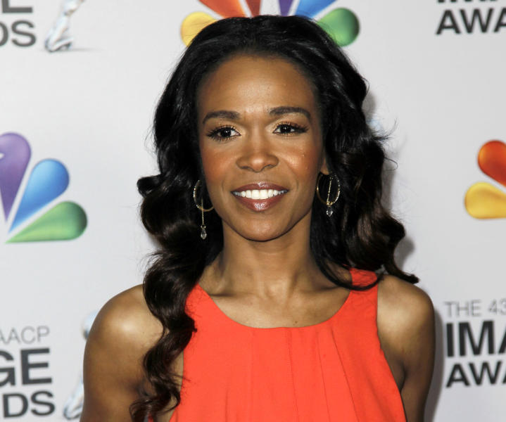 """FILE - This Feb. 17, 2012 file photo shows singer-actress Michelle Williams at the 43rd NAACP Image Awards in Los Angeles. Williams is joining the latest national tour of the musical """"Fela!"""" Producers said Thursday, Jan. 3, 2013, the singer who starred on the UPN sitcom """"Half & Half"""" will be onstage when the tour opens at Sidney Harman Hall in Washington, D.C., on Jan. 29. Williams, part of Destiny's Child along with Kelly Rowland and Beyonce, is now solo artist who released the dance album """"Unexpected"""" and the single """"On The Run."""" (AP Photo/Matt Sayles, file)"""