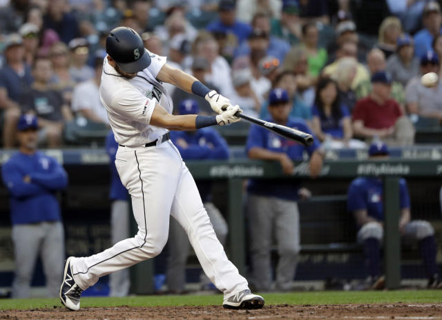 Seattle Mariners' Austin Nola connects for a three-run home run against the Texas Rangers in the second inning of a baseball game Monday, July 22, 2019, in Seattle. (AP Photo/Elaine Thompson)