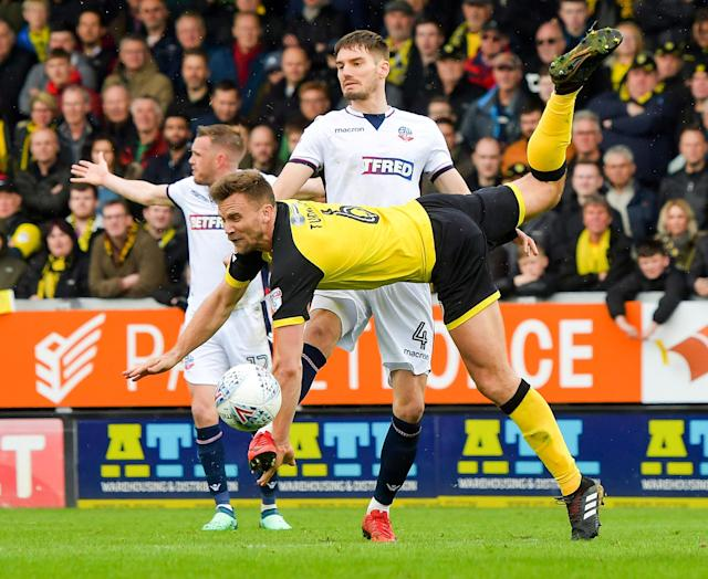"Soccer Football - Championship - Burton Albion vs Bolton Wanderers - Pirelli Stadium, Burton, Britain - April 28, 2018 Burton Albion's Ben Turner in action with Bolton Wanderers' Dorian Dervite Action Images/Paul Burrows EDITORIAL USE ONLY. No use with unauthorized audio, video, data, fixture lists, club/league logos or ""live"" services. Online in-match use limited to 75 images, no video emulation. No use in betting, games or single club/league/player publications. Please contact your account representative for further details."