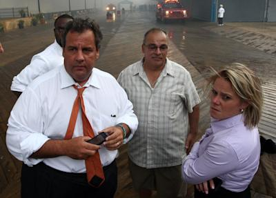 In this Sept. 12, 2013 photo provided by the Office of the Governor of New Jersey, Deputy Chief of Staff Bridget Anne Kelly, right, stands with Gov. Chris Christie, left, during a tour of the Seaside Heights, N.J. boardwalk after it was hit by a massive fire. Christie fired Kelly Thursday, Jan. 9, 2014, and apologized over and over for his staff's stupid behavior, insisting during a nearly two-hour news conference that he had no idea anyone around him had engineered traffic jams as part of a political vendetta against a Democratic mayor. (Office of Gov. Chris Christie, Tim Larsen/AP/Photo)
