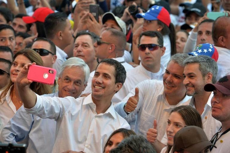 Guaido takes a selfie with his wife Fabiana Rosales (R, foreground), presidents Sebastian Pinera of Chile (L), Ivan Duque of Colombia (2-R) and Mario Abdo Benitez of Paraguay (R) during an aid concert in Colombia on February 22