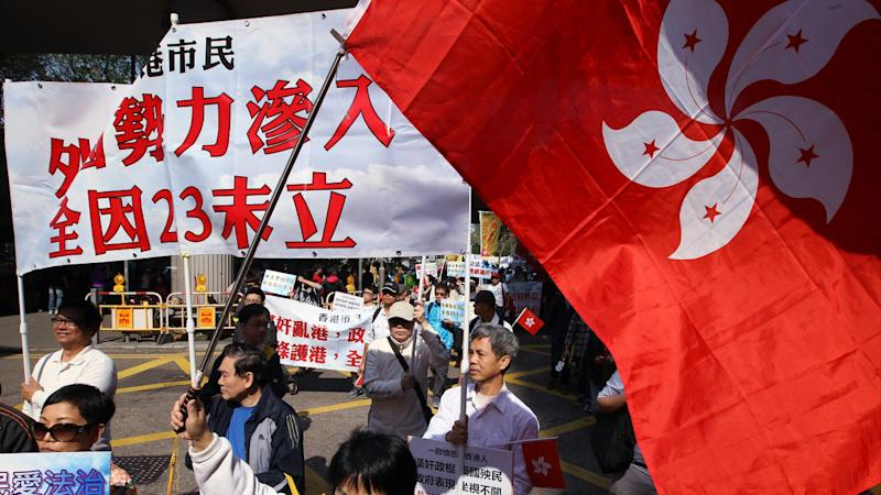 Political reform and national security law can be achieved 'at the same time', Hong Kong think tank claims