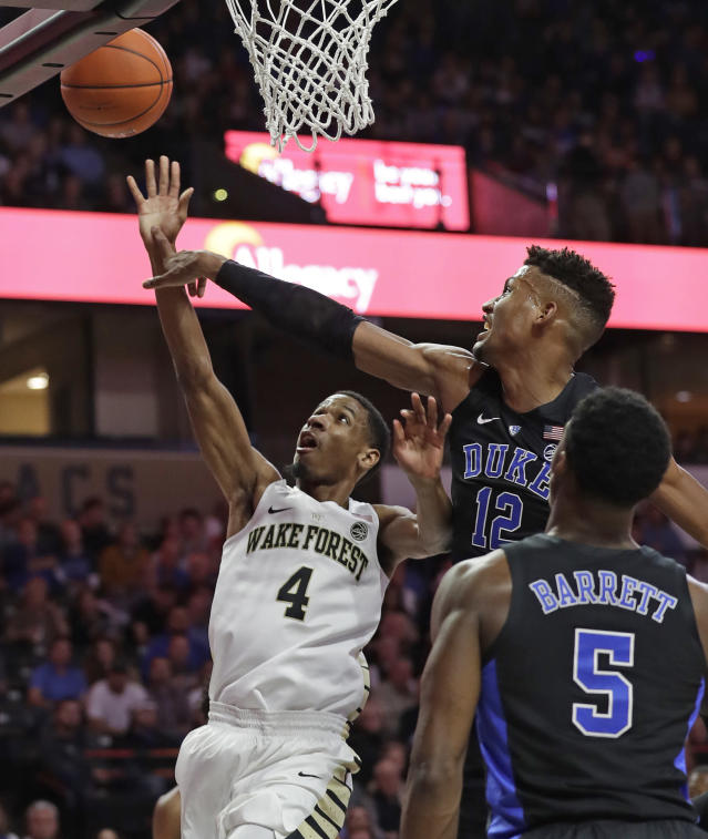 Duke's Javin DeLaurier (12) blocks a shot by Wake Forest's Torry Johnson (4) during the first half of an NCAA college basketball game in Winston-Salem, N.C., Tuesday, Jan. 8, 2019. (AP Photo/Chuck Burton)
