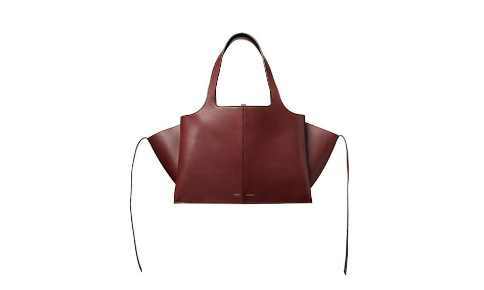 "<p>Celine never disappoints, and the Tri-fold is everything we want in a bag.</p><p>Celine Burnt Red Tri-Fold Bag, $3400, available at <a href=""https://www.celine.com/en/collections/fall/leather-goods/medium-tri-fold-bag-natural-calfskin/178883AHL.28BD"" rel=""nofollow noopener"" target=""_blank"" data-ylk=""slk:Celine"" class=""link rapid-noclick-resp"">Celine </a>Madison 870 Madison Ave, New York, NY 10021, (212) 535-3703</p>"