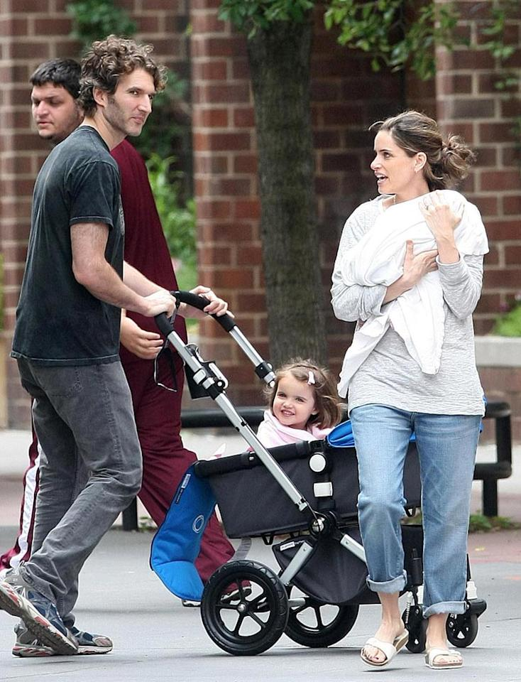 "Amanda Peet cradled her brand new baby girl Molly June in her arms while her hubby, David Benioff, gave big sis Frances Pen a ride in downtown Manhattan Sunday. Props to Amanda for looking pretty incredible after having given birth just one month ago! Daniel/Sean/<a href=""http://www.infdaily.com"" target=""new"">INFDaily.com</a> - May 23, 2010"
