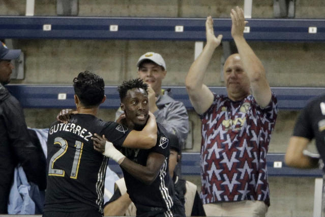 Sporting Kansas City forward Gerso Fernandes, right, celebrates with midfielder Felipe Gutierrez (21) after scoring a goal during the first half of the team's MLS soccer match against the Colorado Rapids on Saturday, Sept. 21, 2019, in Kansas City, Kan. (AP Photo/Charlie Riedel)