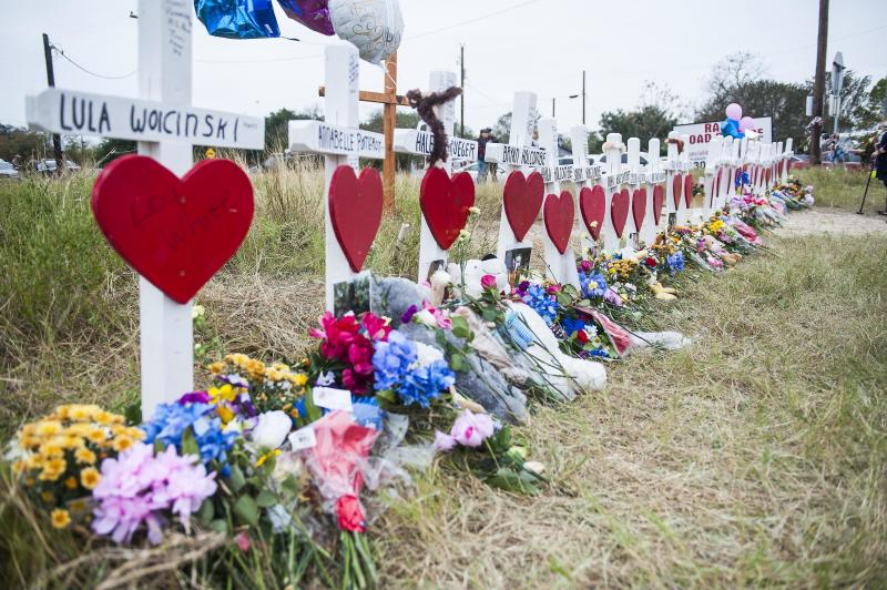 A memorial draws tributes to the victims of the mass shooting at First Baptist Church in Sutherland Springs, Texas, on Friday. (Laura Schimmel/Padre Ryan Photography for HuffPost)