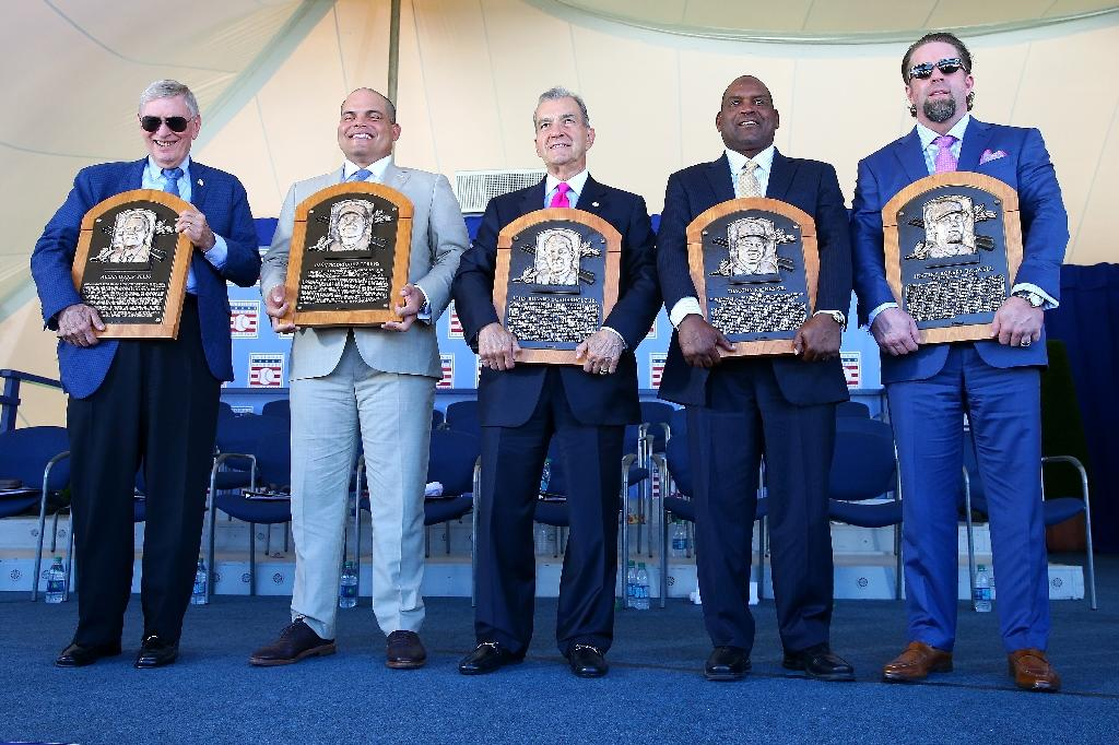 Bud Selig, Ivan Rodriguez, John Schuerholz, Tim Raines and Jeff Bagwell pose for a photo at Clark Sports Center during the Baseball Hall of Fame induction ceremony (AFP Photo/Mike Stobe)