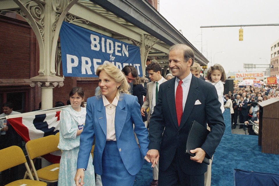Sen. Joseph Biden, D-Del., right, walks with his wife Jill after announcing his candidacy for president June 9, 1987, in Wilmington, Del. (AP Photo/George Widman)