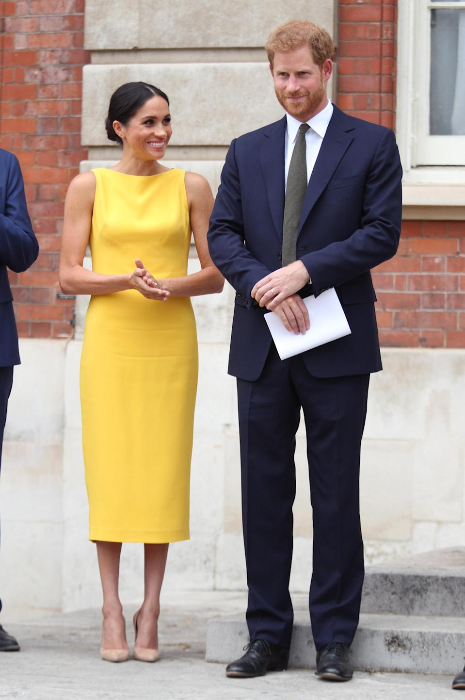 On July, the Duchess of Sussex threw royal fans off guard with her return to vibrant hues in a Brandon Maxwell dress [Photo: Getty]