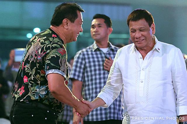 President Rodrigo Roa Duterte shares a light moment with House Speaker Pantalon Alvarez as the latter celebrated his birthday at the New Tagum City Hall in Davao del Norte on January 12, 2017. KARL NORMAN ALONZO/PRESIDENTIAL PHOTO